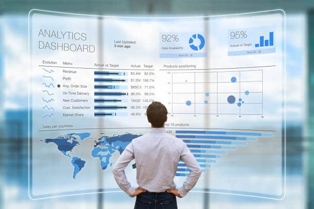 Business Strategy man gazing at data displayed in front of him